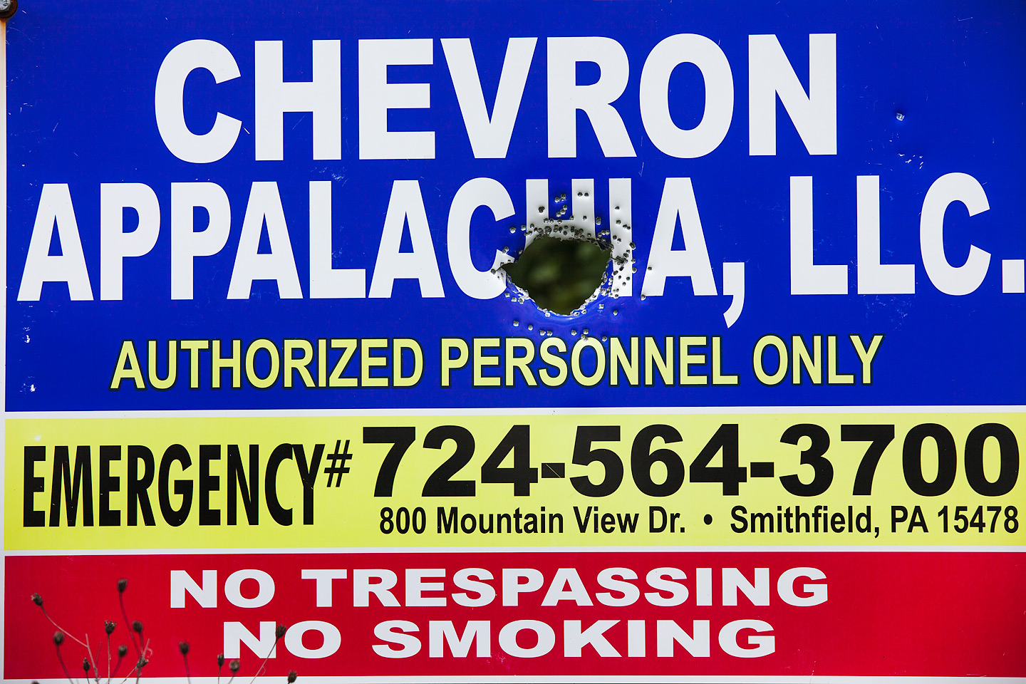 Shot up signage belonging to Chevron Appalachia in Snow Show Township in Centre County, Pennsylvania.